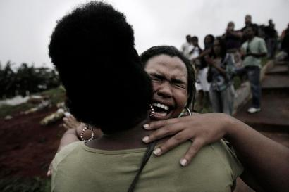 Funeral of Sergio Santos, 24, a newspaper vendor who was allegedly mistaken with a criminal by police and shot to death in his own neighborhood, in Salvador, Bahia. April 21, 2010.