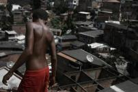 """Alison, 12, says: """"I have seen many people die here"""". In Rocinha do IAPI slum, where Janaina, 13, and Gabriela, 16, were tortured and decapitated by drug traffickers, in Salvador, Bahia. November 24, 2010."""