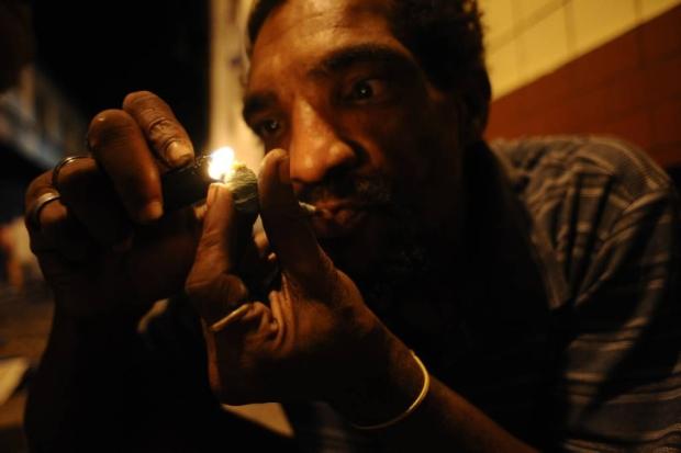 A drug user consumes crack in the old center of Salvador da Bahia March 19, 2012. REUTERS / Lunae Parracho