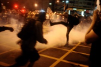 Demonstrators clash with riot police during a protest on the streets of Rio de Janeiro on June 30, 2013, a few hours before the final of the Fifa Confederations Cup football tournament between Brazil and Spain. REUTERS / Lunaé Parracho