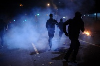 Protesters running from the clouds of tear gas during an anti-government protest in Rio de Janeiro, Brazil, on June 30, 2013. Police clashed with protesters in the streets a few hours before the final of the Fifa Confederations Cup football tournament between Brazil and Spain. Tens of thousands of Brazilians have taken to the streets this month in the biggest protests in 20 years, fuelled by an array of grievances ranging from corruption to poor public services and the high costs of World Cup soccer stadiums. REUTERS / Lunaé Parracho